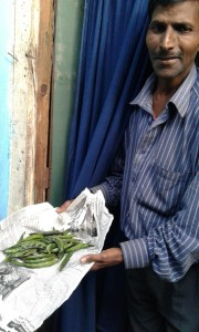 Mangal Singh, receiving the last distribution of NESFAS Community Garden veggies...